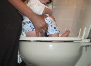 Drop the prefold from the front, let it hang from the back, and the potty opp is still easy pee-zy.
